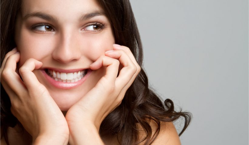 The woman has beautiful and vibrant teeth.