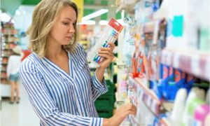 a woman carefully making choices for her dental care products