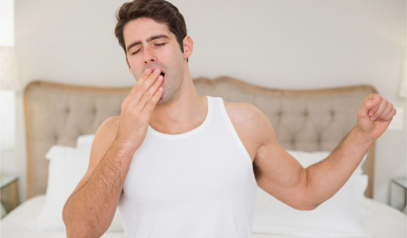 man waking up with dry mouth